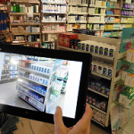 Un commercial Urgo et sa tablette en pharmacie